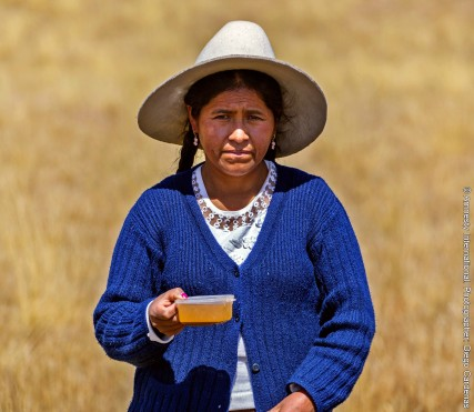 CARMEN CATALINA CHAMBI holding a cup of contaminated water taken from a water source in her community - edited