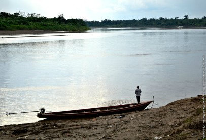 Fisherman on the shore of the river by the community of Cuninico - edited